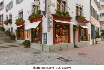 Zurich, Switzerland - December 6, 2015: a street in the historic part of the city of Zurich with stores decorated for Christmas. Zurich is known for its well preserved medieval old town.