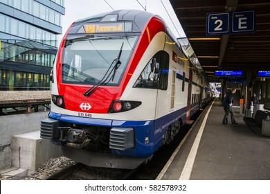 ZURICH, SWITZERLAND - FEB 4, 2017: Swiss Federal Railway Stadler RABe511 S-bahn suburban double decker train at platform of Zurich Hardburke Station