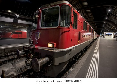 ZURICH, SWITZERLAND - FEBRUARY 23, 2016: Electric locomotive Re 4/4 at Zurich Central station, one of the busiest stations in the world.