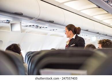 ZURICH, SWITZERLAND - JAN 26, 2015: Unidentified Steward in the plane of the Swiss International Air Lines,  flag carrier airline of Switzerland
