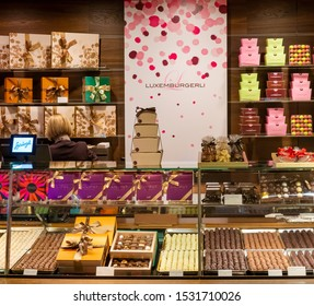 ZURICH, SWITZERLAND - JANUARY 07, 2019 : Showcases famous  macaroon cookies ( luxemburgerli )  in 60 years old Confiserie Sprungli Swiss luxury store on Bahnhofstrasse in Zurich, Switzerland.