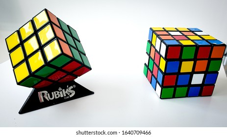 ZURICH, SWITZERLAND - JANUARY 2020: Two Rubik Cubes combination puzzles in scrambled status