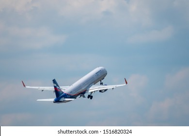 Zurich, Switzerland - July 19, 2018: Aeroflot airlines company airplane flying in cloudy sky