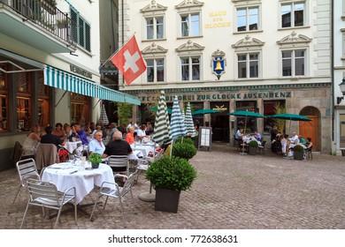 ZURICH, SWITZERLAND - JULY 25, 2014: People having lunch at the Glockengasse street town square in Zurich, Switzerland, on July 25, 2014