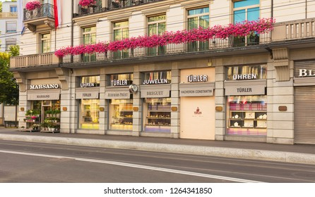 Zurich, Switzerland - July 30, 2016: stores on Bahnhofstrasse street in the city of Zurich. Bahnhofstrasse is Zurich's main downtown street and one of the world's most expensive shopping avenues.