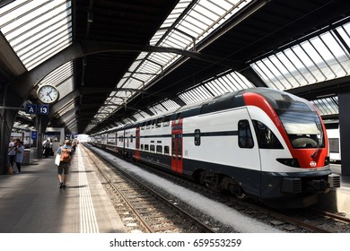 Zurich, Switzerland - June 03, 2017: People near the train on . Zurich central train station (Zurich Hauptbahnhof).