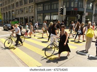 Zurich, Switzerland - June 03, 2017: People on zebra crossing in Zurich. Daily life in Zurich. Daily life in Zurich.