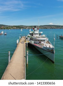 Zurich, Switzerland - June 1, 2019: Stadt Zurich steamboat at a pier. Stadt Zurich is owned and operated by the Lake Zurich Navigation Company, which is a public Swiss company.