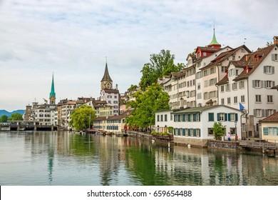 Zurich, Switzerland - June 10, 2017: Zurich downtown, with Fraumunster and St. Peter. View towards Lindenhof, Schipfe street, river Limmat in front.