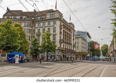Zurich, Switzerland - June 10, 2017: Inner city of Zurich, Paradeplatz with Savoy Hotel Baur en Ville, view from shopping promenade called Bahnhofstrasse.