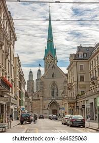 Zurich, Switzerland - June 10, 2017: Minster Fraumunster and Grossmunster, street view downtown Zuerich.