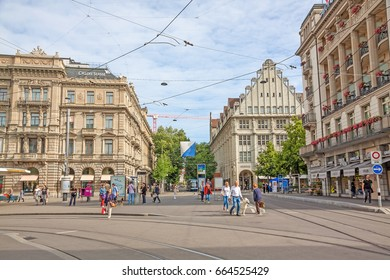 Zurich, Switzerland - June 10, 2017: Square Paradeplatz , inner city of Zurich, view towards shopping promenade called Bahnhofstrasse.