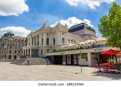 Zurich, Switzerland - June 10, 2017: Zurich Opera house building (Opernhaus Zuerich) - side view from Sechselautenplatz, Bernhard Bar Cafe in front.