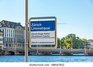 """Zurich, Switzerland - June 10, 2017: Sign at Limmatquai near river Limmat signed with """"Zurich Limmatquai"""" - port Enge """"Enge Hafen"""" - Museum """"Landesmuseum"""""""