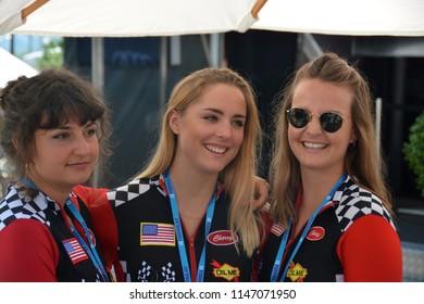 ZURICH / SWITZERLAND - JUNE 10 2018: Three young ''Cherry' hospitality girls during the ABB FIA Formula E Zurich ePrix on June 10, 2018 in Zurich, Switzerland.