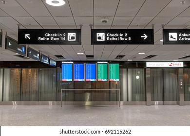 Zurich, Switzerland - June 11, 2017: Departe / Arrival signboard, signs to check-in counters at zurich airport
