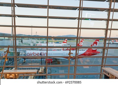 Zurich, Switzerland - June 11, 2017: Airport Zurich - view through window of waiting area - planes of Air Berlin and Swiss airline in a row