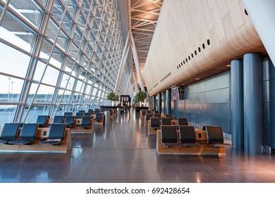 Zurich, Switzerland - June 11, 2017: Airport Zurich waiting area after check-in - airfield aside