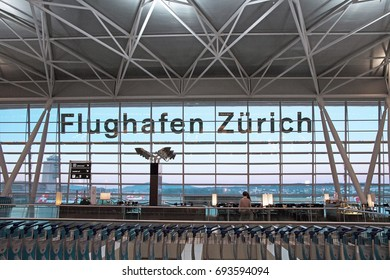 Zurich, Switzerland - June 11, 2017: Airport Zurich (Flughafen Zurich) waiting area after check-in - view towards airfield with lettering