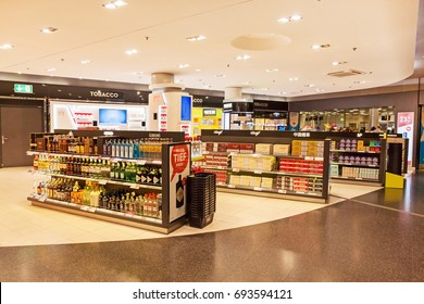 Zurich, Switzerland - June 11, 2017: Airport Zurich duty free shop with bottles of alcohol and cigarettes