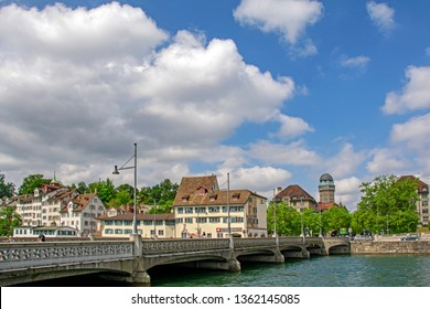 Zurich, Switzerland - June 14, 2015: Beautiful cityscape with Rudolf Brun Bridge, gothic buildings, Urania Sternwarte observatory and Limmat river under the blue sky with white clouds