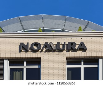 Zurich, Switzerland - June 18, 2017: upper part of a building bearing the sign of Nomura Holdings, Inc., which is a Japanese financial holding company and a principal member of the Nomura Group.