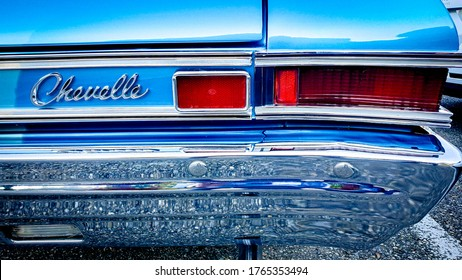Zurich, Switzerland - June, 2020: Closeup of logo and backlight of a blue vintage 60's Chevrolet Chevelle