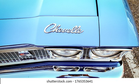 Zurich, Switzerland - June, 2020: Closeup of logo and frontlight of a blue vintage 60's Chevrolet Chevelle