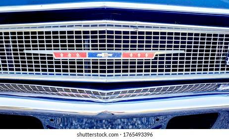 Zurich, Switzerland - June, 2020: Closeup of vintage Chevrolet logo on frontgrill