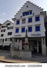 Zurich, Switzerland - June 21 2017: Historic bildings in the center of the city and streets of Zurich in Switzerland
