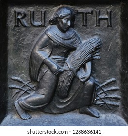 "ZURICH, SWITZERLAND - JUNE 23, 2018: The pious Ruth, relief on the door of the Grossmunster (""great minster"") church in Zurich, Switzerland"