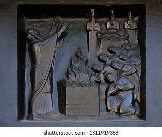 "ZURICH, SWITZERLAND - JUNE 23, 2018: Thou shalt have no other gods beside me - Elijah on the Carmel, relief on the door of the Grossmunster (""great minster"") church in Zurich, Switzerland"
