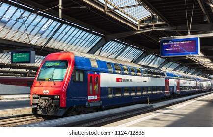 Zurich, Switzerland - June 30, 2018: a passenger train at a platform of the Zurich main railway station. Zurich main railway station is the largest and busiest railway station in Switzerland.
