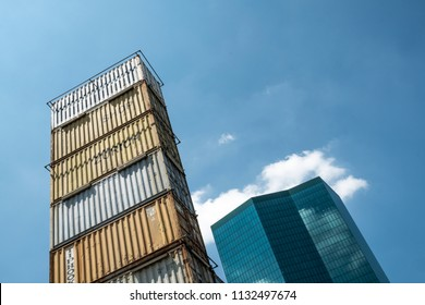 ZURICH, SWITZERLAND - JUNE 30, 2018: View of modern Prime Tower and Freitag Tower, built out of shipping containers for a store for Swiss recycled bag brand Freitag in Zurich-West.