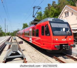 Zurich, Switzerland - June 5, 2019: a train of the Uetliberg railway line at the station on the top of Mt. Uetliberg. The railway line connects the Zurich main station with the top of the Uetliberg.