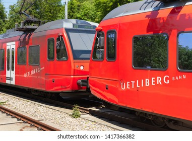 Zurich, Switzerland - June 5, 2019: two locomotives of a train of the Uetliberg railway line (German: Uetlibergbahn) standing at the station on the top of Mt. Uetliberg, main focus on the closer one.