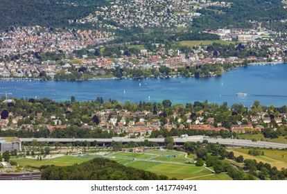 Zurich, Switzerland - June 5, 2019: Lake Zurich as seen from Mt. Uetliberg. The Uetliberg is a mountain offering a panoramic view of the entire Lake Zurich.