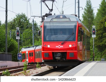 Zurich, Switzerland - June 5, 2019: a passenger train of the Uetliberg railway line arriving to the station on the top of Mt. Uetliberg, main focus on the front of the locomotive.