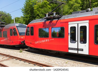 Zurich, Switzerland - June 5, 2019: two locomotives of a passenger train of the Uetliberg railway line standing at the station on the top of Mt. Uetliberg.
