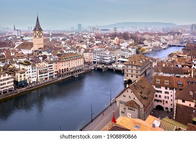 Zurich, Switzerland - March 15, 2014: Aerial view on Church of St. Peter and the Limmat river from Grossmunster, one of the four main churches of Zurich.