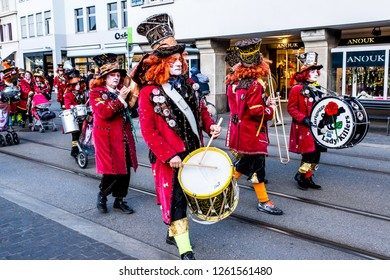 Zurich, Switzerland - March 2017: People marching and playing instruments in Zurich carnival parade