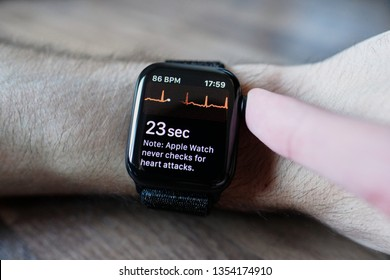 Zurich, Switzerland - March 30, 2019: Apple Watch Series 4 ECG on man's arm, electrocardiogram / electrocardiograph  demonstration