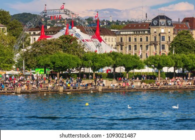Zurich, Switzerland - May 11, 2018: embankment of Lake Zurich in the city of Zurich, venue of the Circus Knie in the background. Zurich is the largest city in Switzerland.
