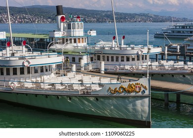 Zurich, Switzerland - May 11, 2018: ships of the Lake Zurich Navigation Company a pier on Lake Zurich. Lake Zurich Navigation Company is a public Swiss company operating passenger ships and boats.