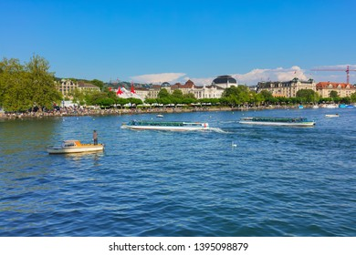 Zurich, Switzerland - May 11, 2018: Lake Zurich, buildings of the city, people on the embankment of the lake. Lake Zurich is a lake in Switzerland, extending southeast of the city of Zurich.