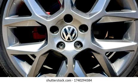 Zurich, Switzerland - May, 2020. Close-up of famous german car manufacturer Volkswagen (VW) logo on grey rim