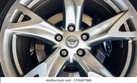 Zurich, Switzerland - May, 2020. Close-up of famous japanese car manufacturer Nissan logo on grey rim
