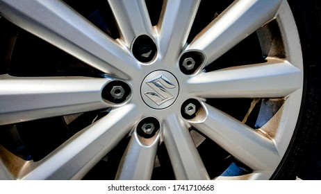 Zurich, Switzerland - May, 2020. Close-up of famous japanese car manufacturer Suzuki Motor Corporation (Suzuki) logo on grey rim