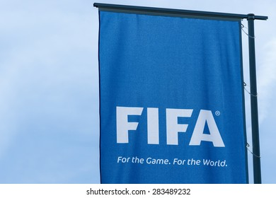 Zurich, Switzerland - May 28 2015. FIFA flag at the entrance to the head office in Zurich