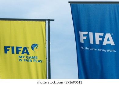 Zurich, Switzerland - May 28 2015. FIFA flags at the entrance to the head office in Zurich